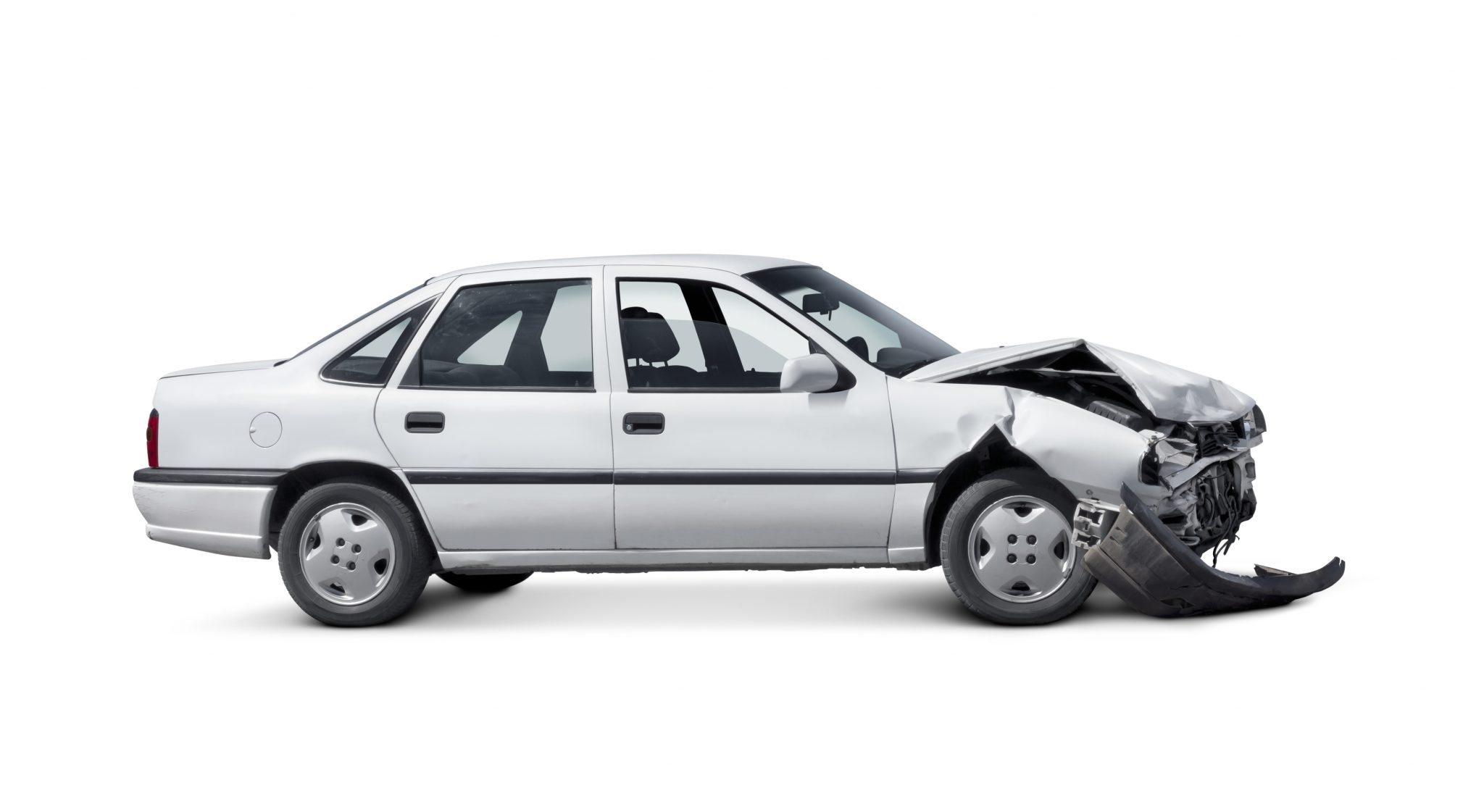 White and damaged sedan car isolated on white background.