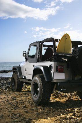 SUV and Surfboard at the Beach