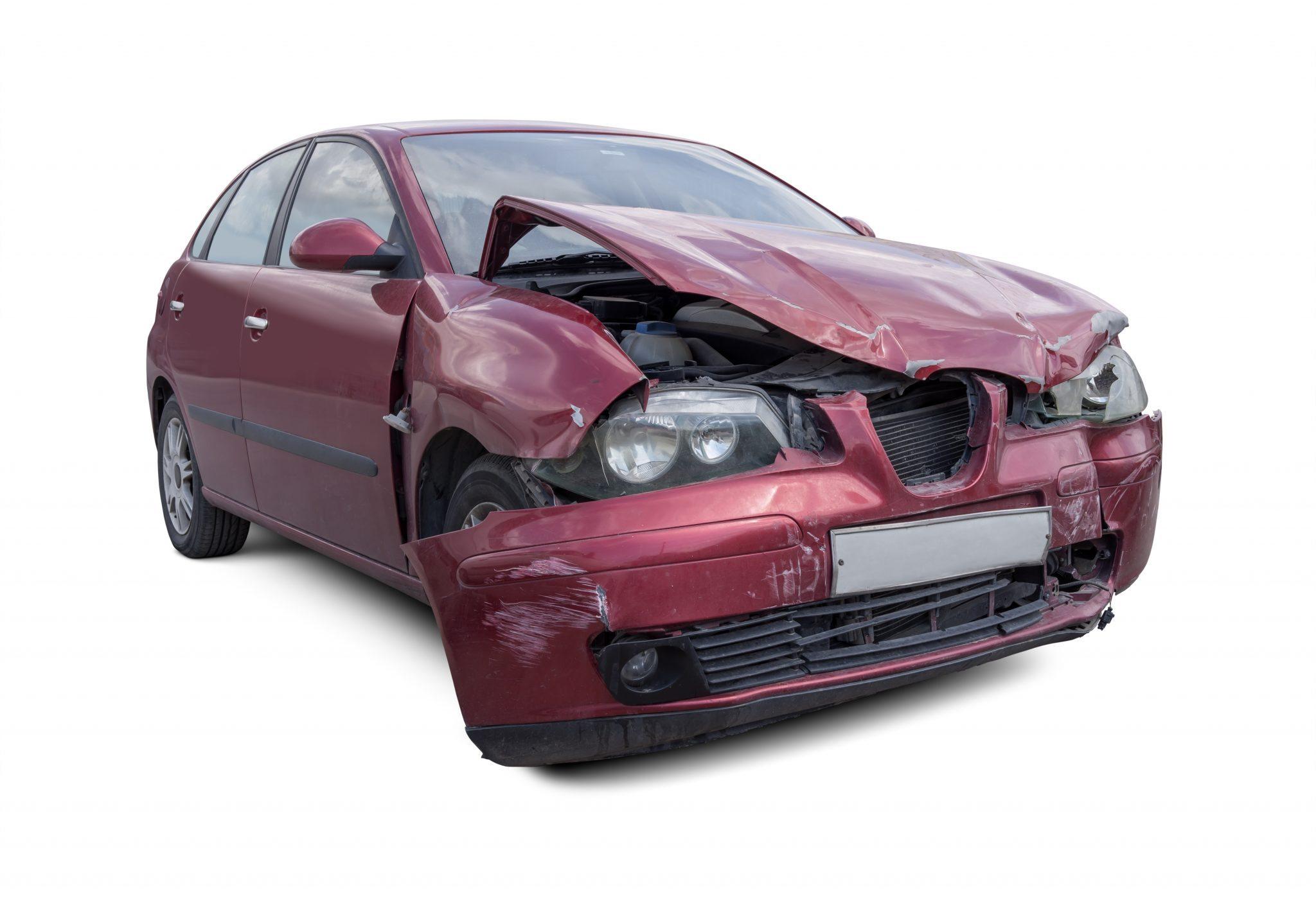 Damaged car isolated on white background.